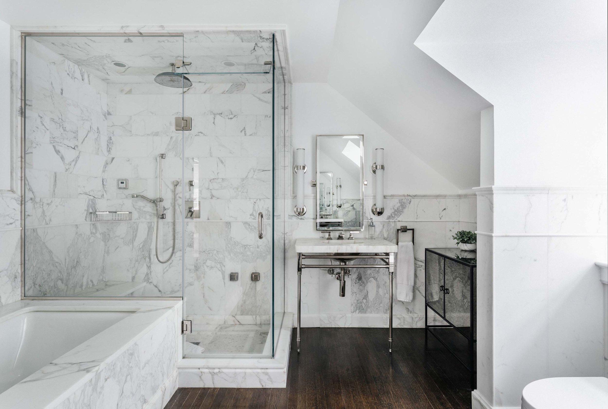 Bathroom with shower cubicle, bathtub and hardwood floor