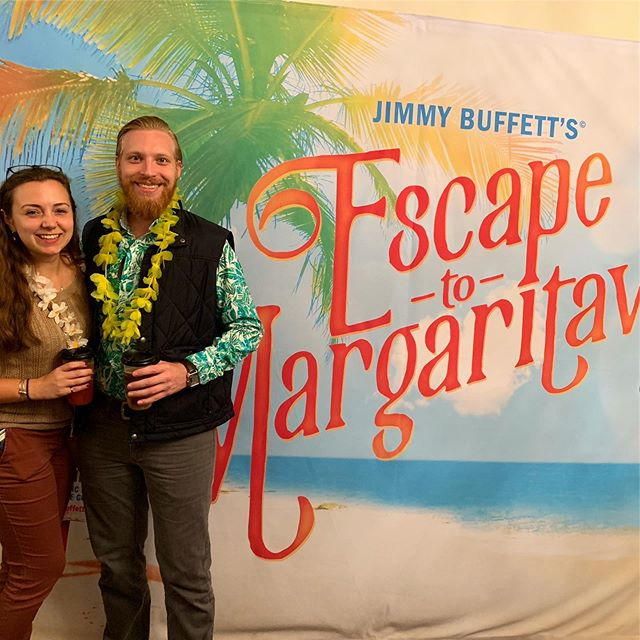 """Katie surprised me with plans to see 'Escape to Margaritaville - The Musical' (HUGE thanks to @samanticss for getting us the tickets). The show was a Parrothead's dream, made even better by a special guest. Just after the second act started, an older gentleman walked in and sat in the empty seat just across the aisle from me. I looked at him and thought """"wow that guy sure looks a lot like Jimmy Buffett"""". He sat there singing along and laughing with the show, until just before the end of the performance. At that point, he got up, jogged backstage, and came out with a guitar to surprise everyone with a live performance of Margaritaville. Turns out Jimmy Buffett """"sure does look a lot like Jimmy Buffett"""" 🦜 #jimmybuffett #parrothead #escapetomargaritaville"""