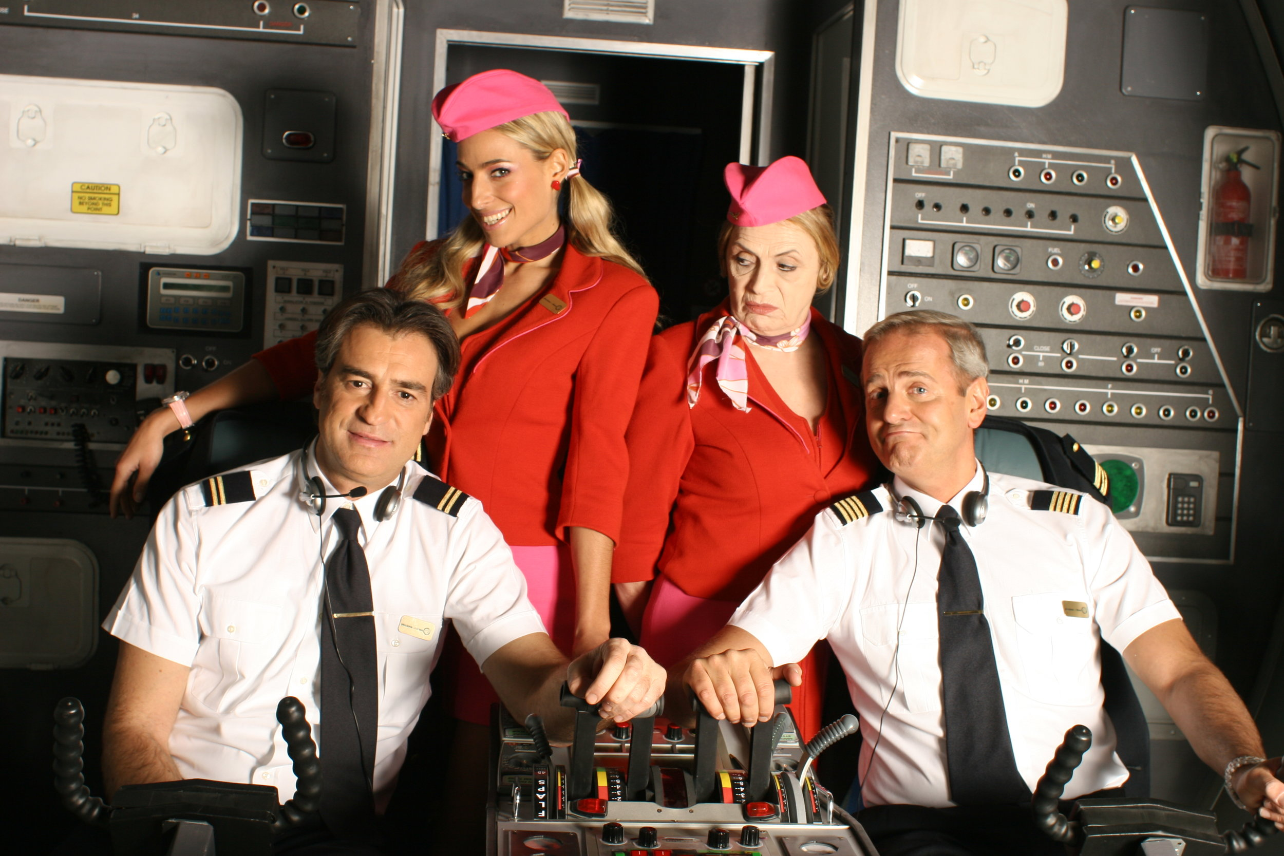 """Jessica and the cast of network sitcom """"Pilots"""" in a promo shot for the series"""