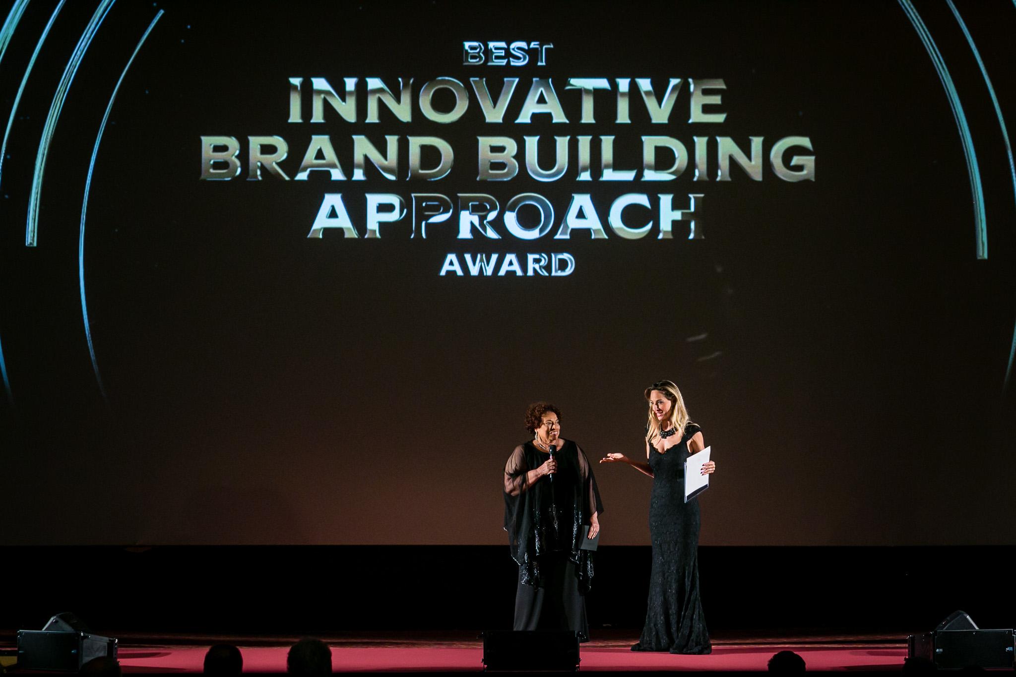 Jessica hosting a private corporate event awards ceremony