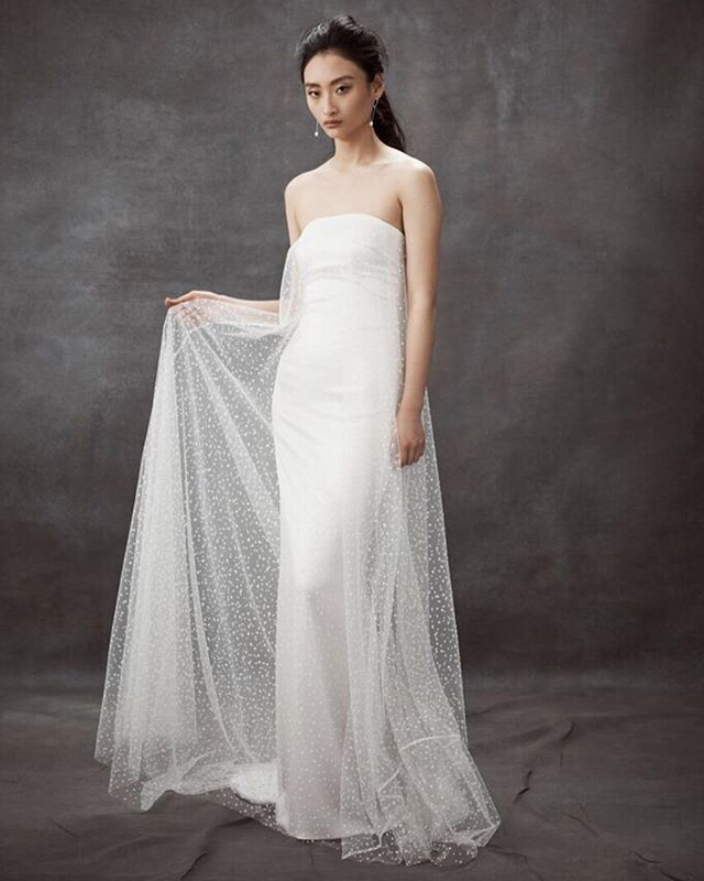 DAN JONES||2020  DAYDREAM ... Velvet spots adorn voluminous soft tulle layers like falling snow flakes over a sheath of silky smooth Tri-Acetate.  Photography @elle4lovephotography  Hair @pietpantano @wildlifehairsydney  MUA @sashanilssonmakeup  #danjones #bride #bridetobe #bridal #nybfw2020  @loho_bride @ritualsoflovebridal @thewhiteroommpls @loversland @spinabride @lunasewickley @thesentimentalistatl @moonlightlaceboutique @jadealexandrabridal @vivienneparisbride @soyoobridal_official @hopexpage @bluebellbridal_ @sphere_collective