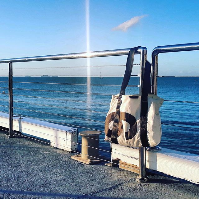 We love it when happy customers send pics of their @recolab_bags out n about. This Trade Winds Tote was spotted hanging around @coralsearesort in beautiful #airliebeach .... weather's beautiful ... wish we were there! 📸@bon_bon_brie  #nofilter#summerholiday#australia#handmade#reuse#sail#beach#airliebeach#farnorthqueensland#sun#giftsforher#mothersday#upcycle#totebag