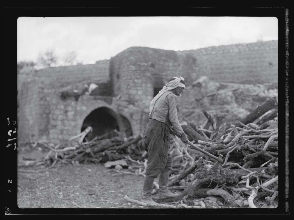 A-hewer-of-wood-in-Palestine.-Chopping-olive-wood.jpg