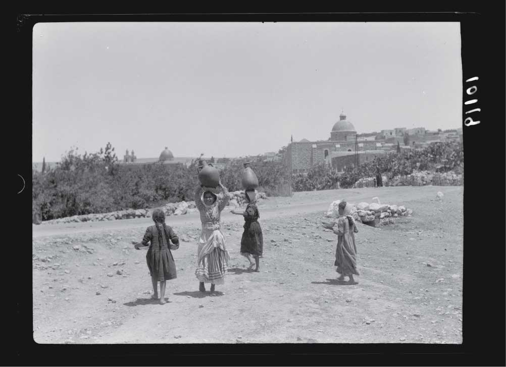 Cana-of-Galilee-young-girls-with-water-jars-on-head-coming-from-spring.jpg