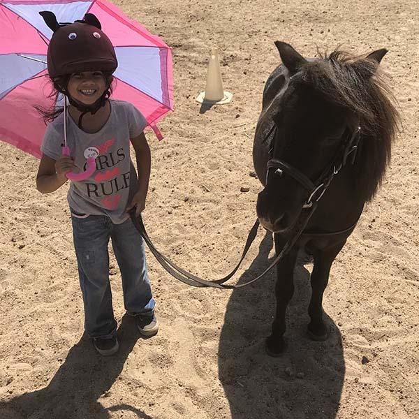 social-emotional-equine-therapy-pink-umbrella.jpg