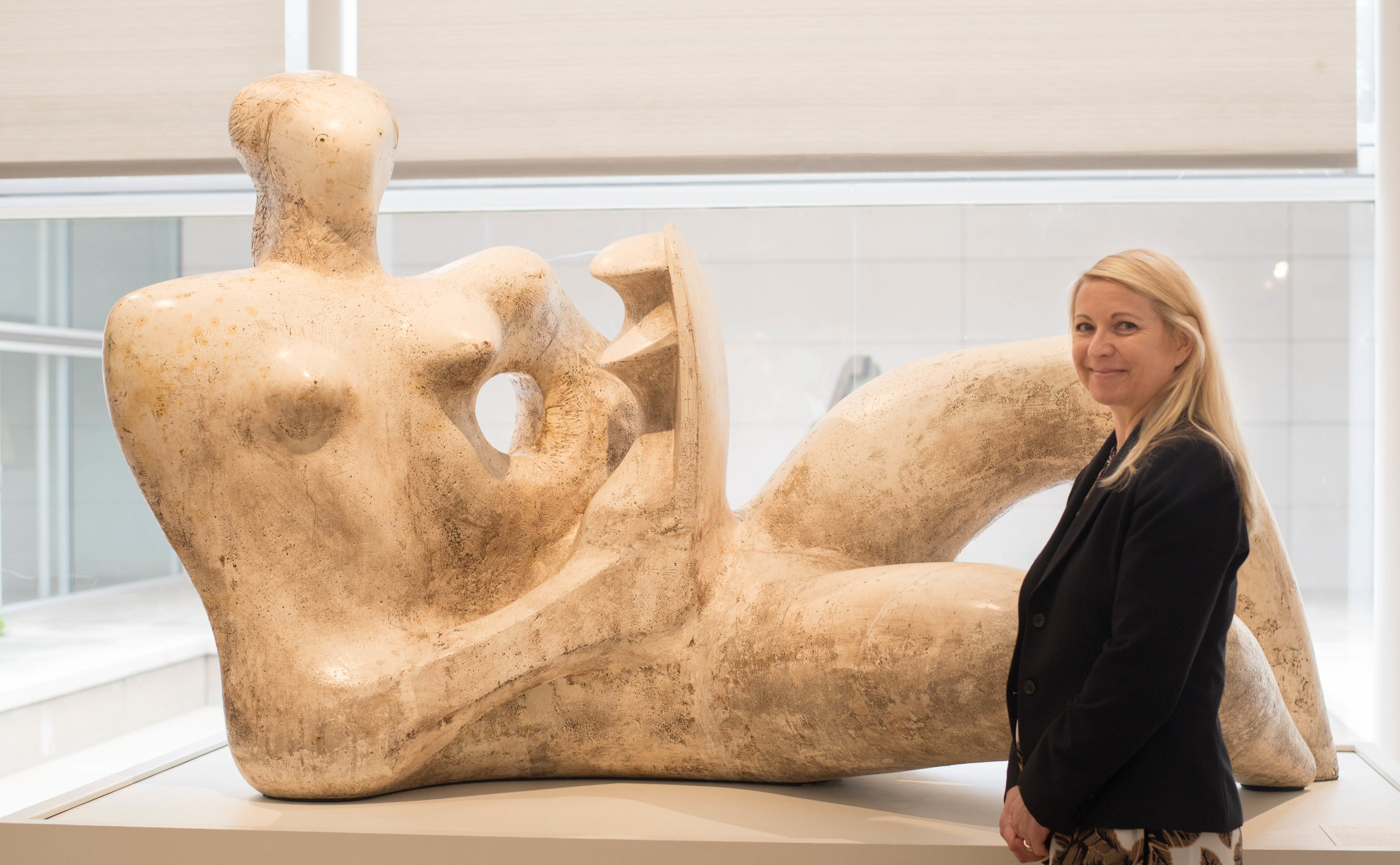 """ISA CAPP Art Appraiser Kim Kasten, pictured with Henry Moore's, """" Reclining Mother and Child,"""" 1974-76, plaster, Dallas Museum of Art."""