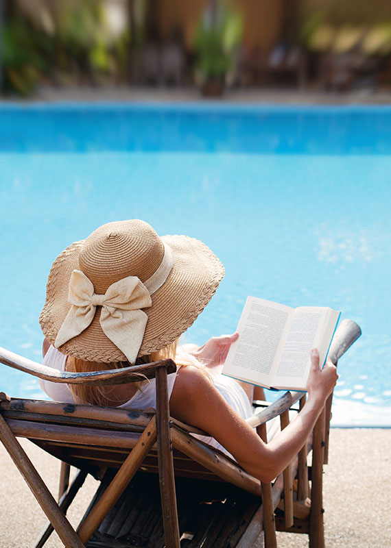 woman-relaxing-by-pool.jpg