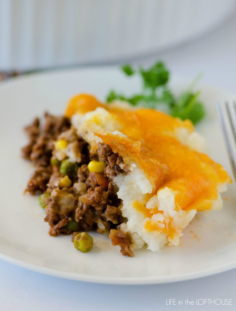 Shepherd's Pie - Recipe and photos via Life in the LofthouseIngredients //Potato Layer3 large russet potatoes2 tablespoons butter½ cup milk1 teaspoon garlic powderMeat Layer2 pounds Redhouse grass-fed, grass-finished Ground Beef1 small onion, chopped2 cloves garlic, minced½ teaspoon sea salt½ teaspoon pepper2 tablespoons flour, or gluten free flour of choice2 tablespoons tomato paste1 cup Redhouse Beef Bone Broth½ tablespoon Worcestershire sauce½ teaspoon dried oregano1 ½ cup frozen peas and carrots½ cup frozen corn (optional)1 cup shredded cheddar cheese