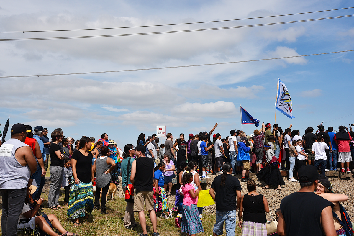 At the gate, after they prayers, before the protectors moved further down the road