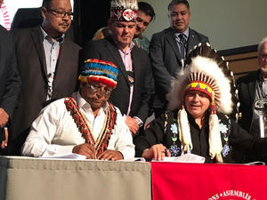 Ecuadorian Indigenous leader Domingo Peas and AFN National Chief Perry Bellegarde sign protocol Dec. 6 in Ottawa to hold Chevron accountable for environmental harms.