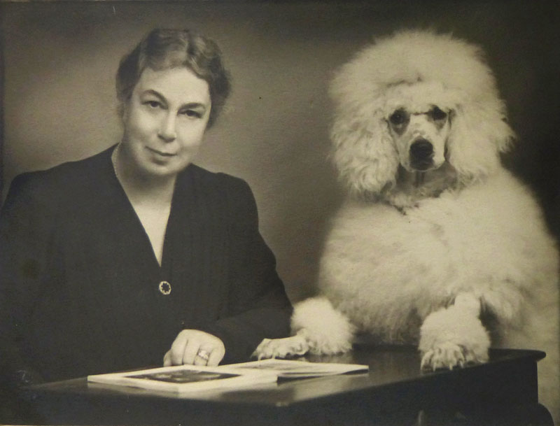 Nellie Ionides and her standard poodle Clicquot