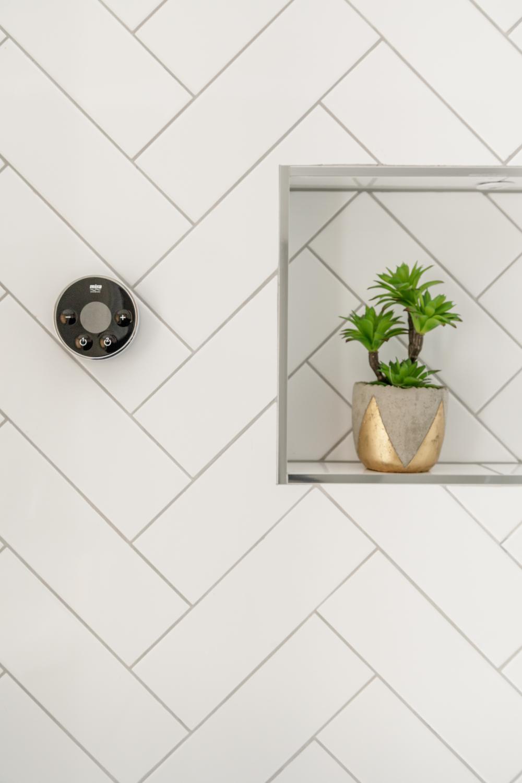 Worthing Builders-ExtraOrdinaryRooms-Arundel renovation bathroom design with herringbone tiles.jpg