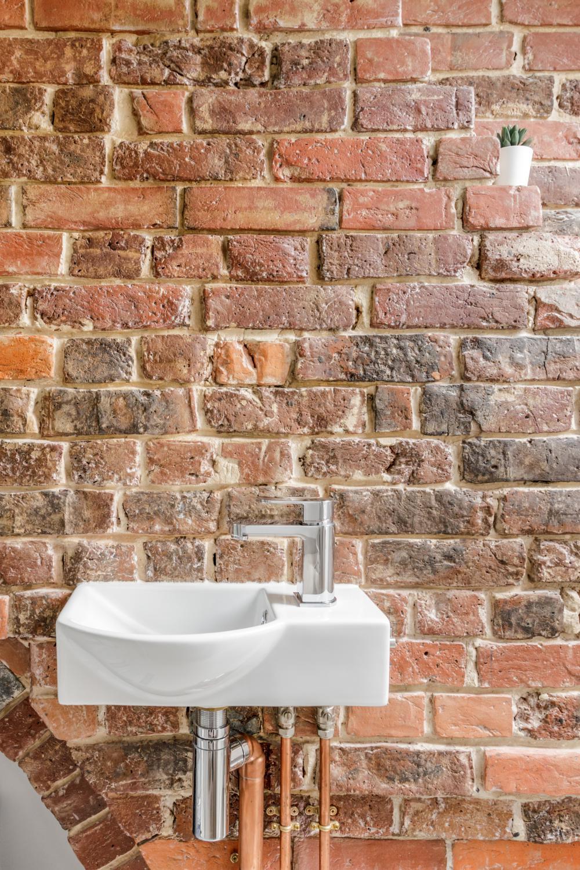 Worthing Builders-ExtraOrdinaryRooms-Arundel renovation Bedroom Exposed Brick.jpg