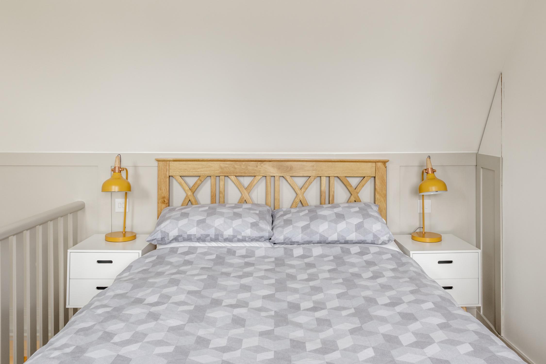 Worthing Builders-ExtraOrdinaryRooms-Arundel renovation Bedroom in the loft with panelling.jpg