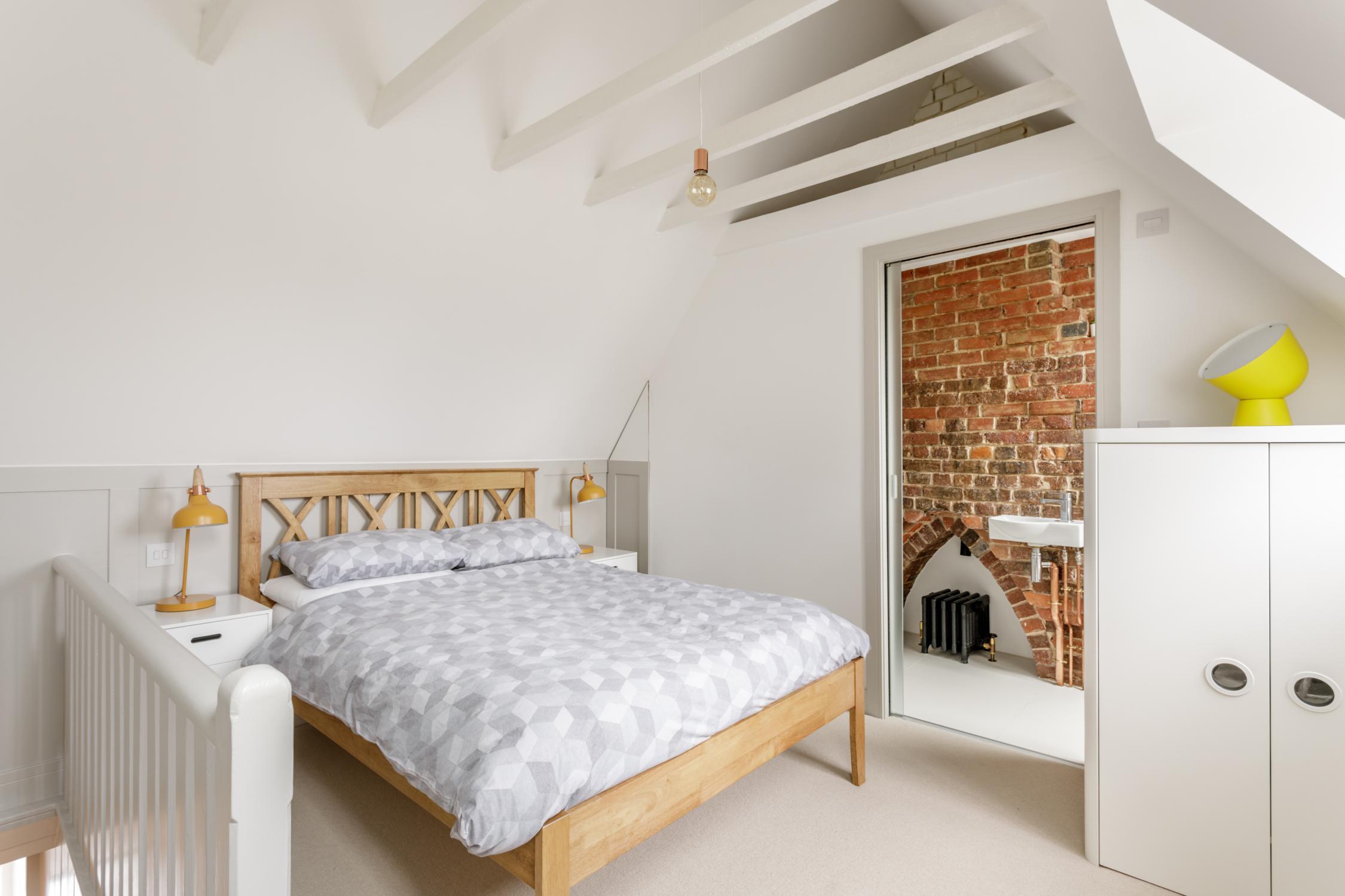 Worthing Builders-ExtraOrdinaryRooms-Arundel renovation Bedroom in the loft.jpg
