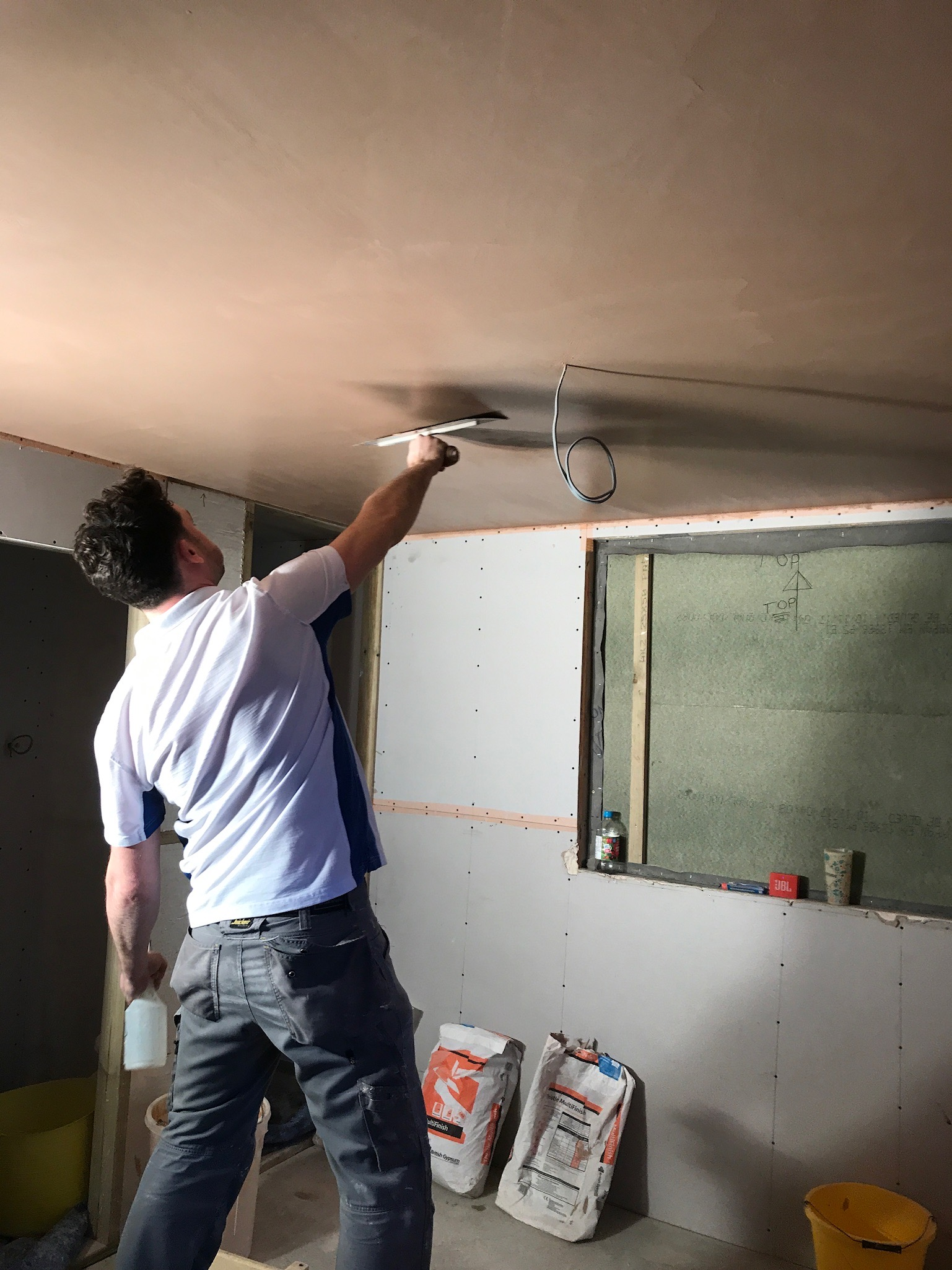 Plastering the ceiling of a loft conversion in Worthing.jpeg