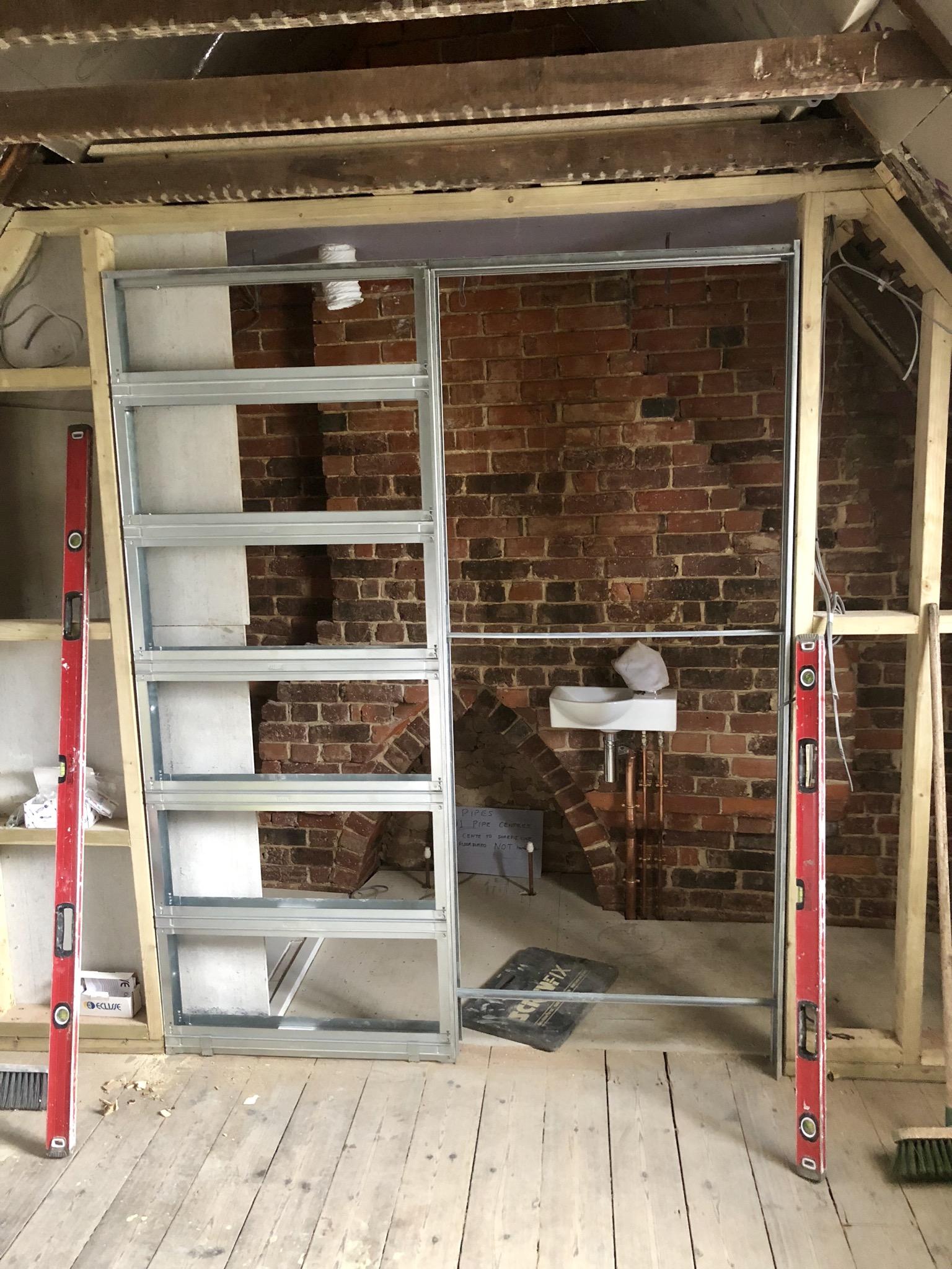 Worthing Builders-ExtraOrdinaryRooms-Arundel renovation Pocket Door.jpg