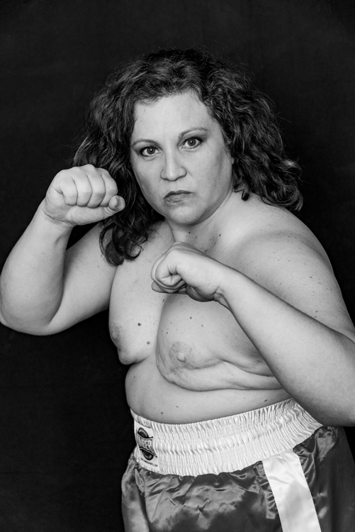 About this photo: Although Jennifer prepared a lot of great props for her boxing themed photo shoot as we continued take photos we striped off her boxing paraphernalia as we went. Gone went her robe, her belt, and finally her gloves for this shot. This image of a bare-knuckled fighter earned the award for evoking the greatest emotional response from her friends and family.