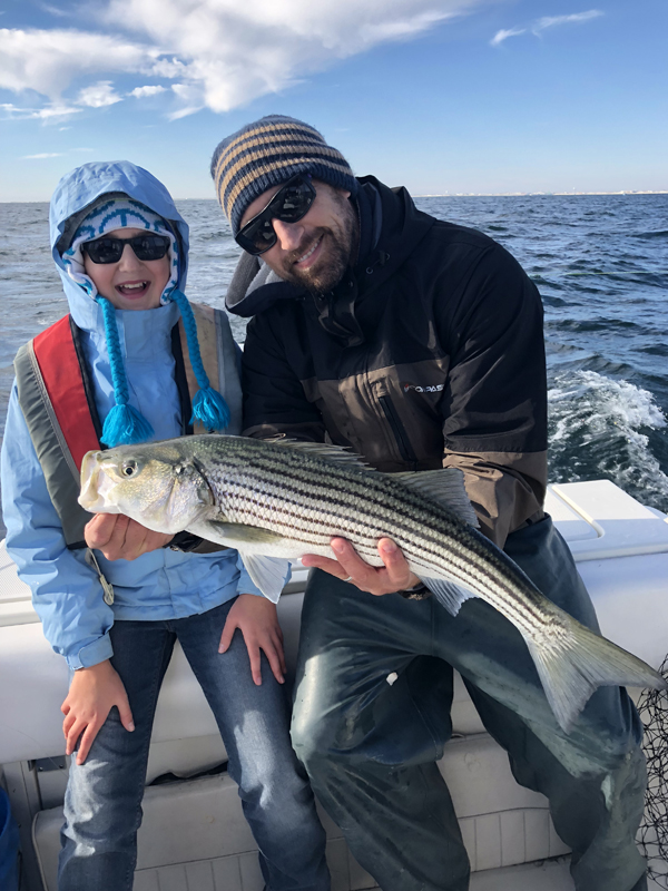 Dave Werner, biology teacher, fisherman, customer and father, talks about the importance of striped bass to our waters. Photo courtesy of Werner.