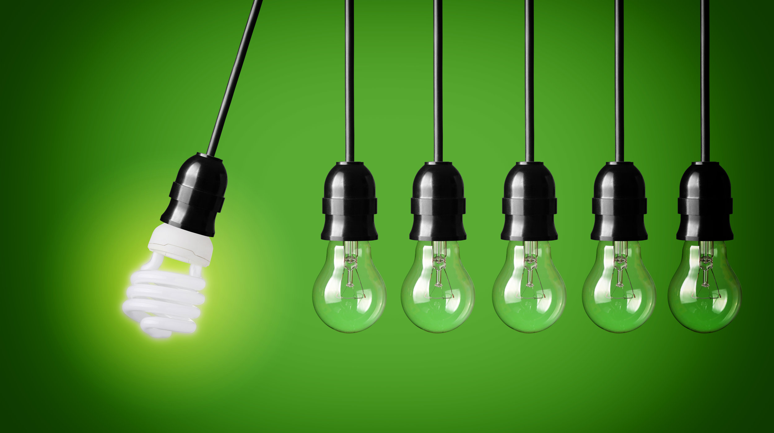 stock-photo-perpetual-motion-with-light-bulbs-and-energy-saver-bulb-idea-concept-on-green-background-130427690.jpg