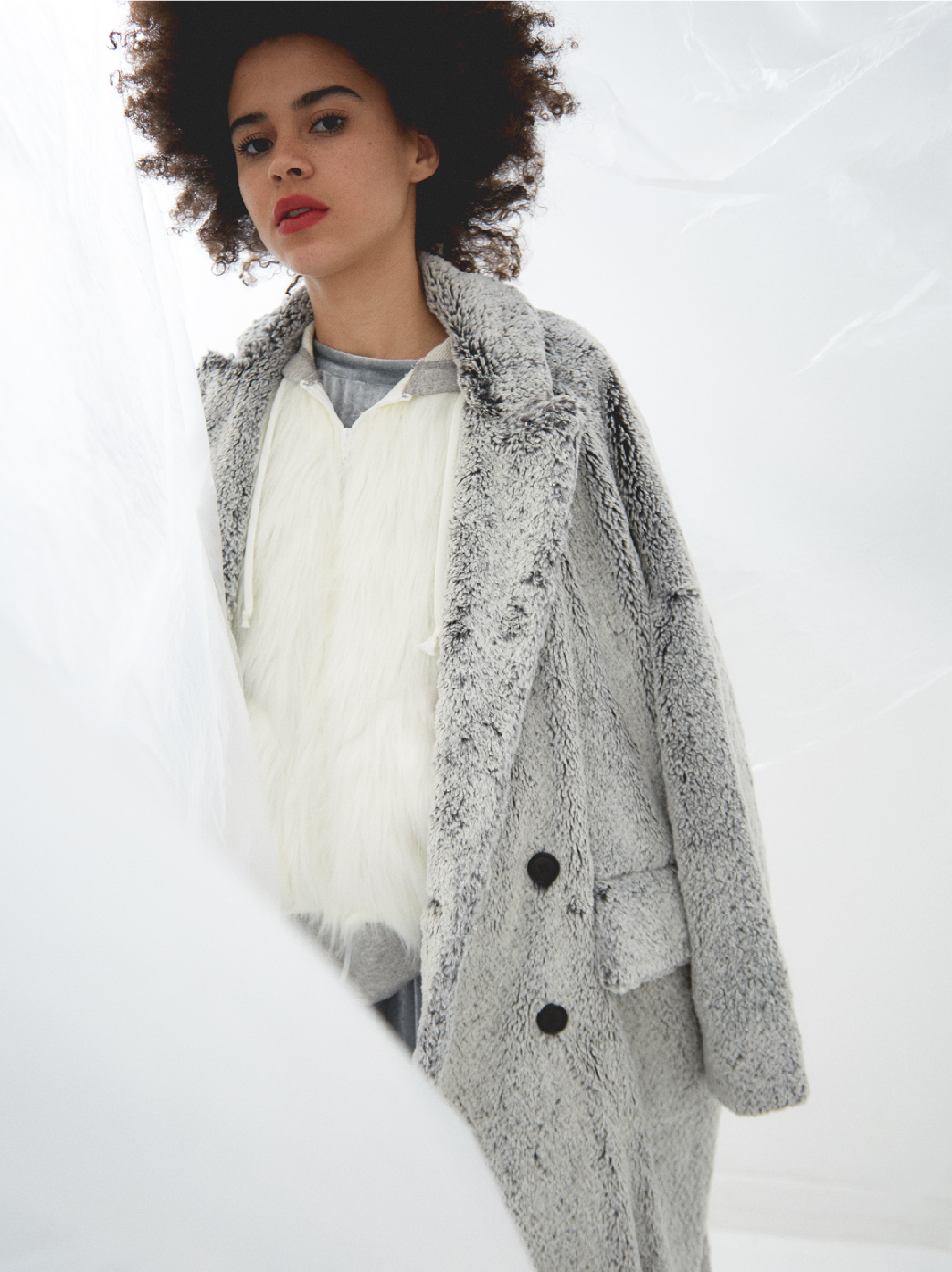 Faux fur and flees provide a soft flowing silhouette