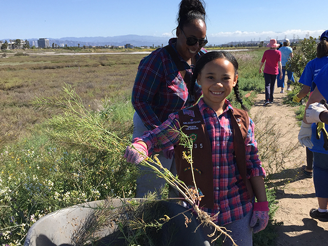 Brownie Troop participates in Community Restoration at the Saltwater Marsh