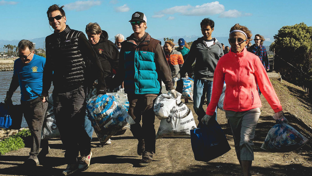 Ballona Creek Clean-up - Group Carrying Trash Bags