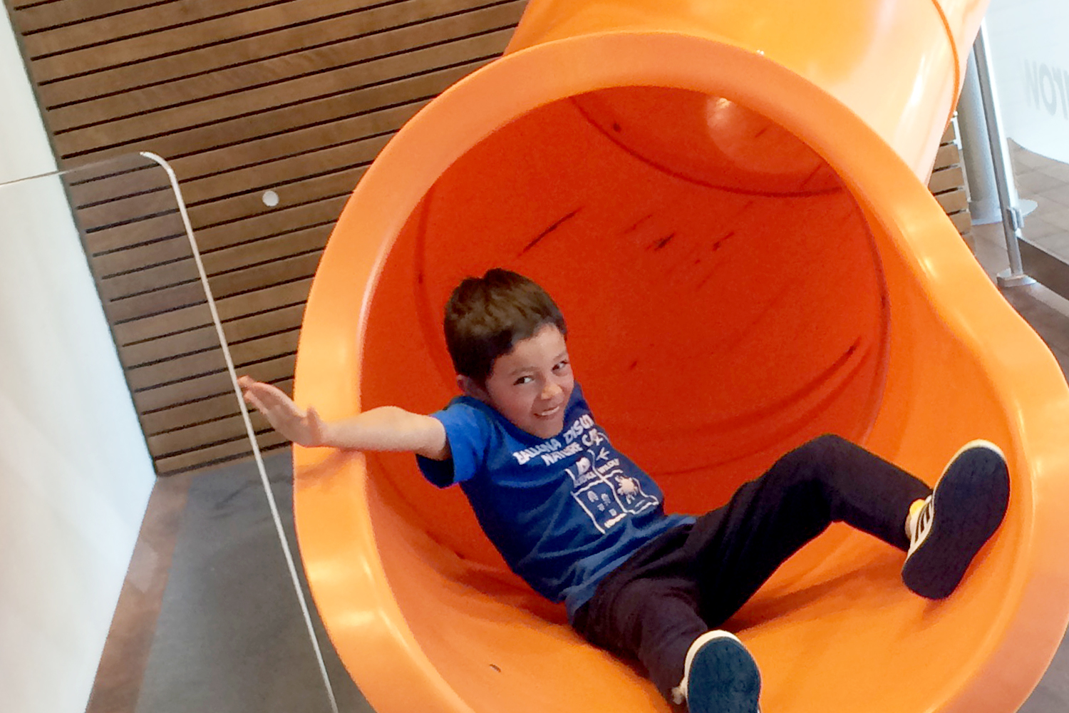 Camper going down slide at offsite location