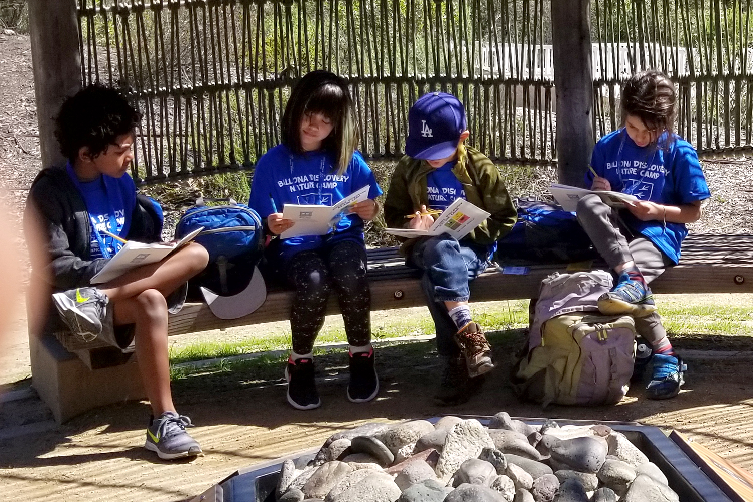 Group of campers working on an assignment at Ballona Discovery Park