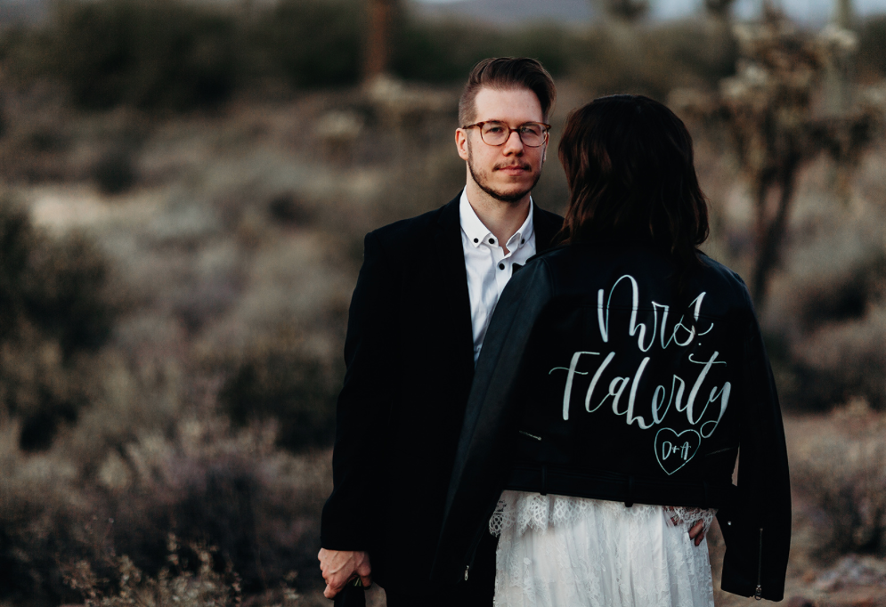 bride and groom with leather jacket in the arizona desert