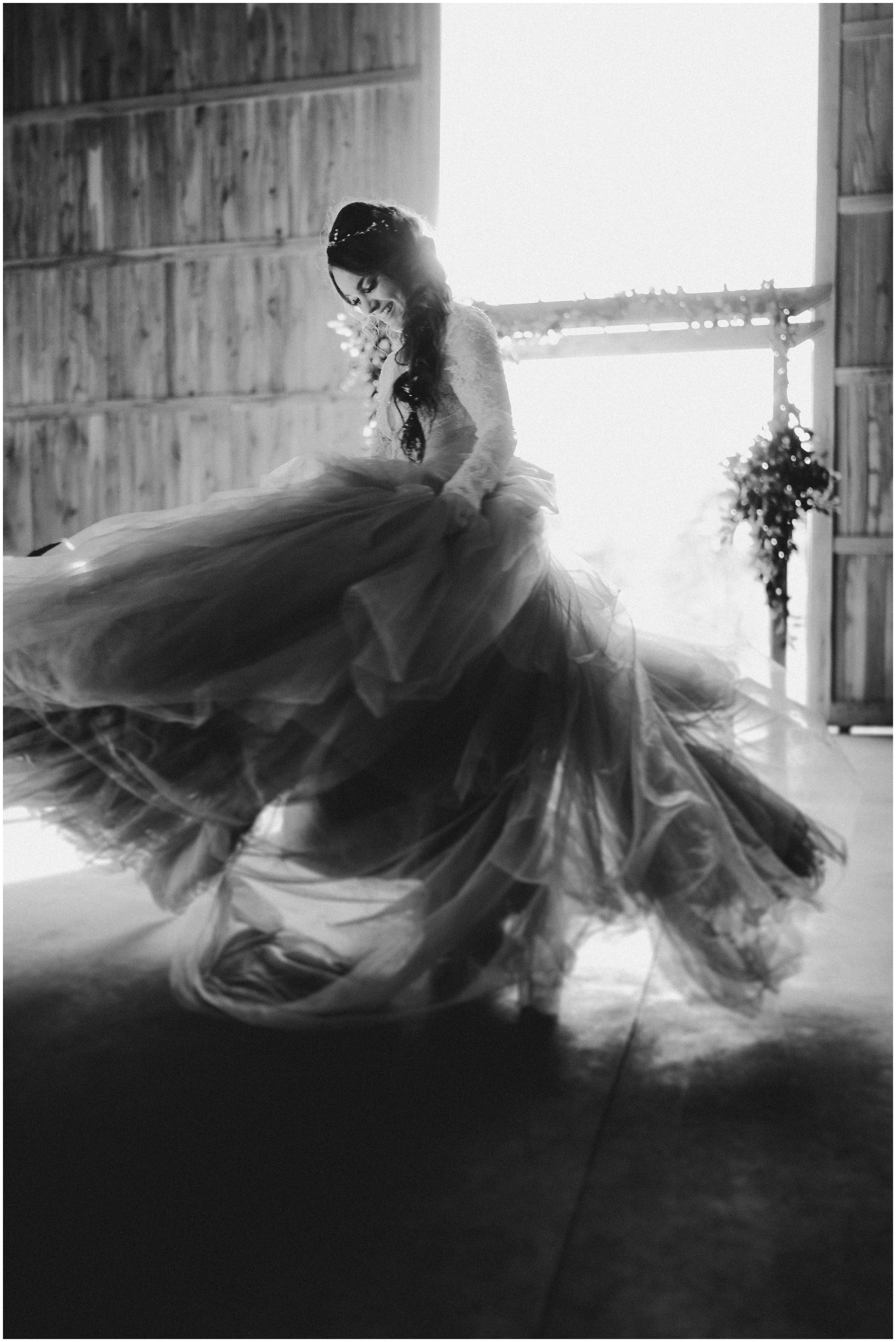 TONY-GAMBINO-PHOTOGRAPHY-BEND-OREGON-WEDDING-SHOOT-000_1542 bride spinning dress.jpg
