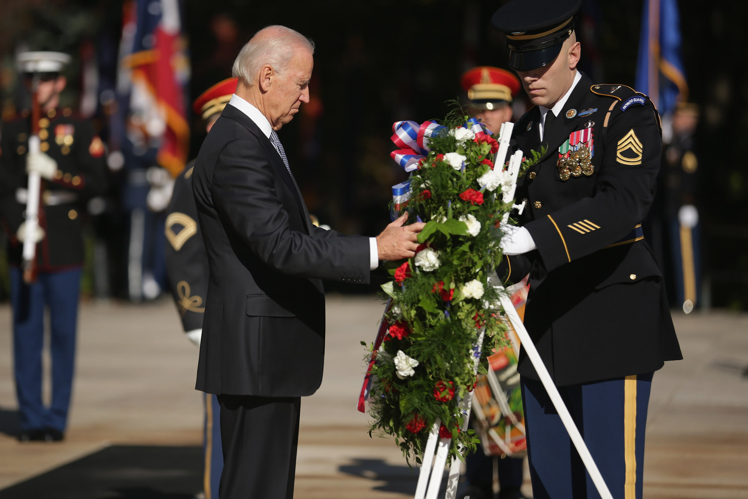 Vice President Joe Biden lays a wreath during a ceremony at the Tomb of the Unknowns during Veterans Day observations at Arlington National Cemetery on Nov. 11, 2014, in Arlington, Virginia. Originally established as Armistice Day in 1919, the holiday was renamed Veterans Day in 1954 by President Dwight Eisenhower. (Photo by Chip Somodevilla/Getty Images)
