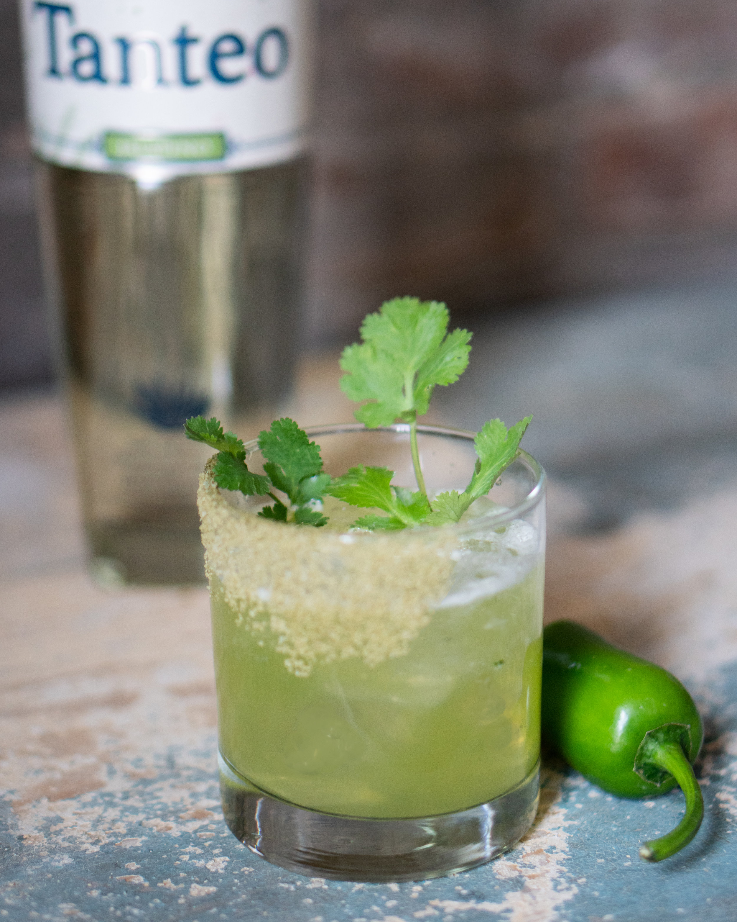 Recipe:    2 oz. Tanteo Jalapeño Tequila    1 oz. Fresh Lime Juice    ¾ oz. Agave Nectar    ½ oz. Muddled Cilantro & Jalapeño Peppers    Rimmed with Tanteo Jalapeño Salt
