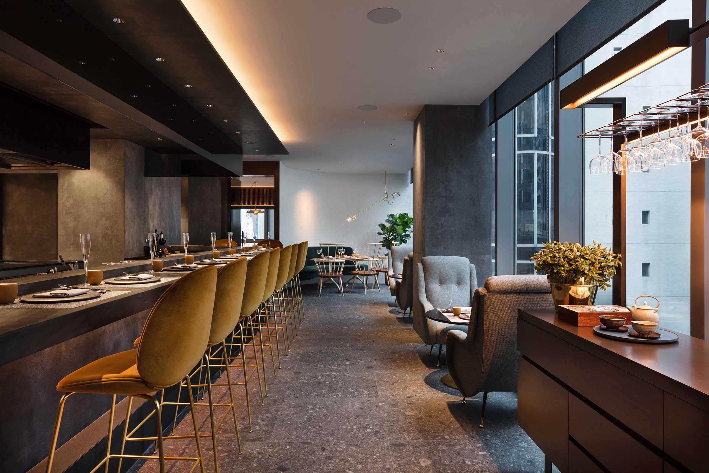 At the kitchen counter are velvet covered bar stools by GamFratesi from  Gubi