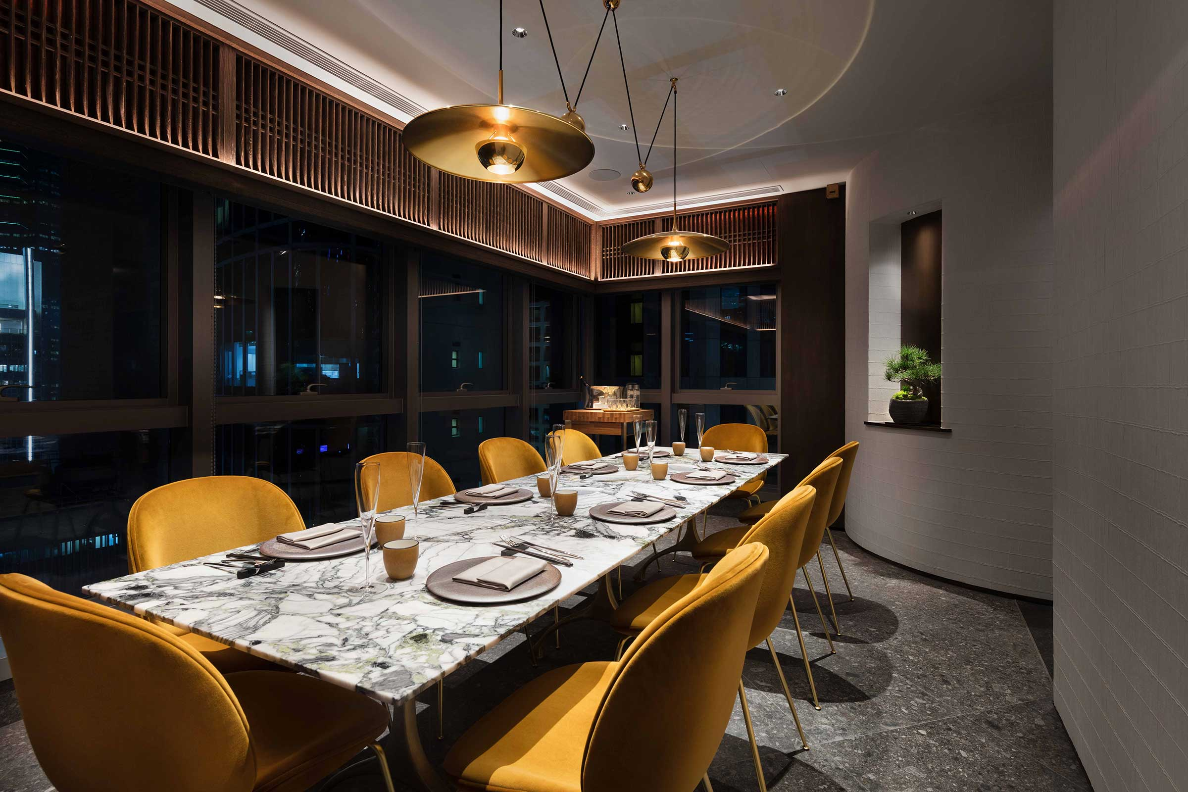 The large brass saucer in the private dining room is by  Florian Schulz