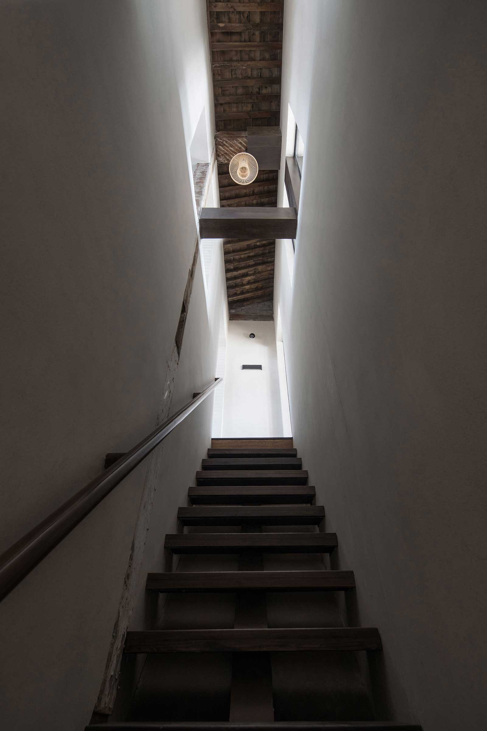 quad-house-ARCHISTRY-nolan-chao-25--first-to-second-floor-stairwell.jpg