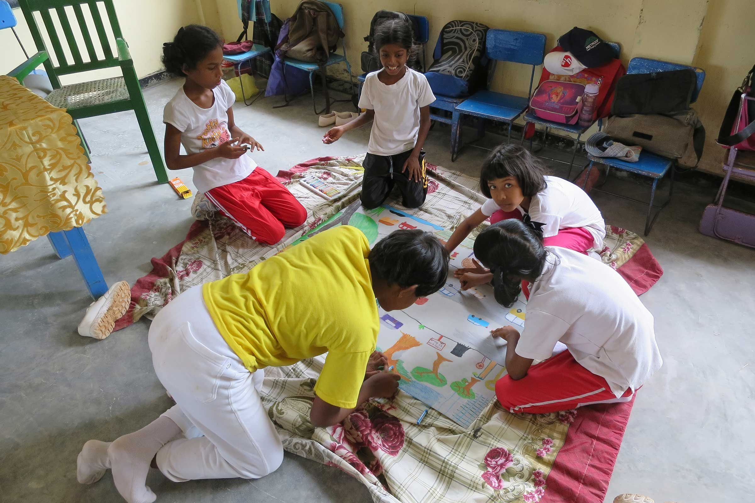 Primary school students attend an art workshop at Mullegama Art Centre.