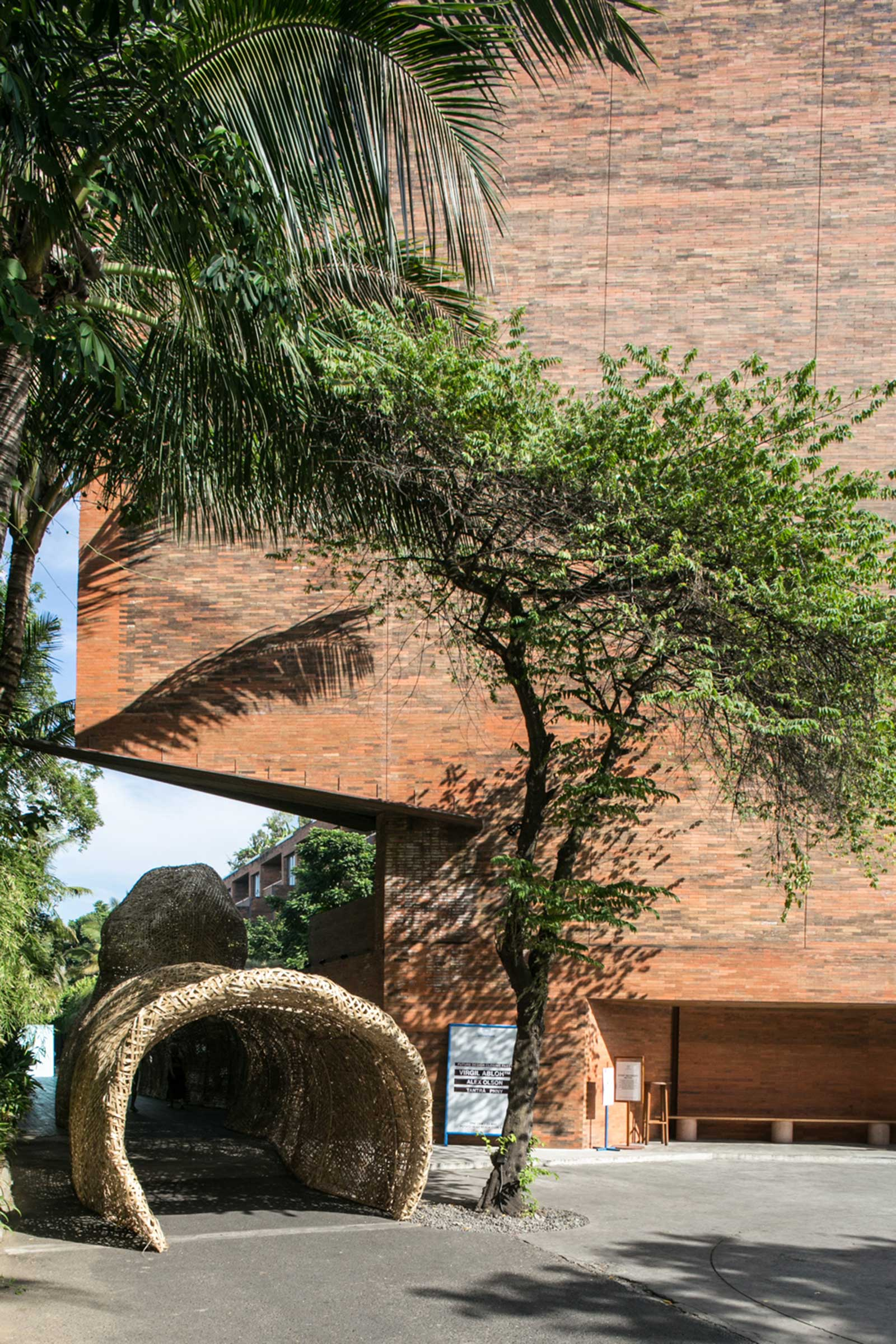 The nano UHERO bamboo tunnel installation beside the distinctive red-brick Katamama