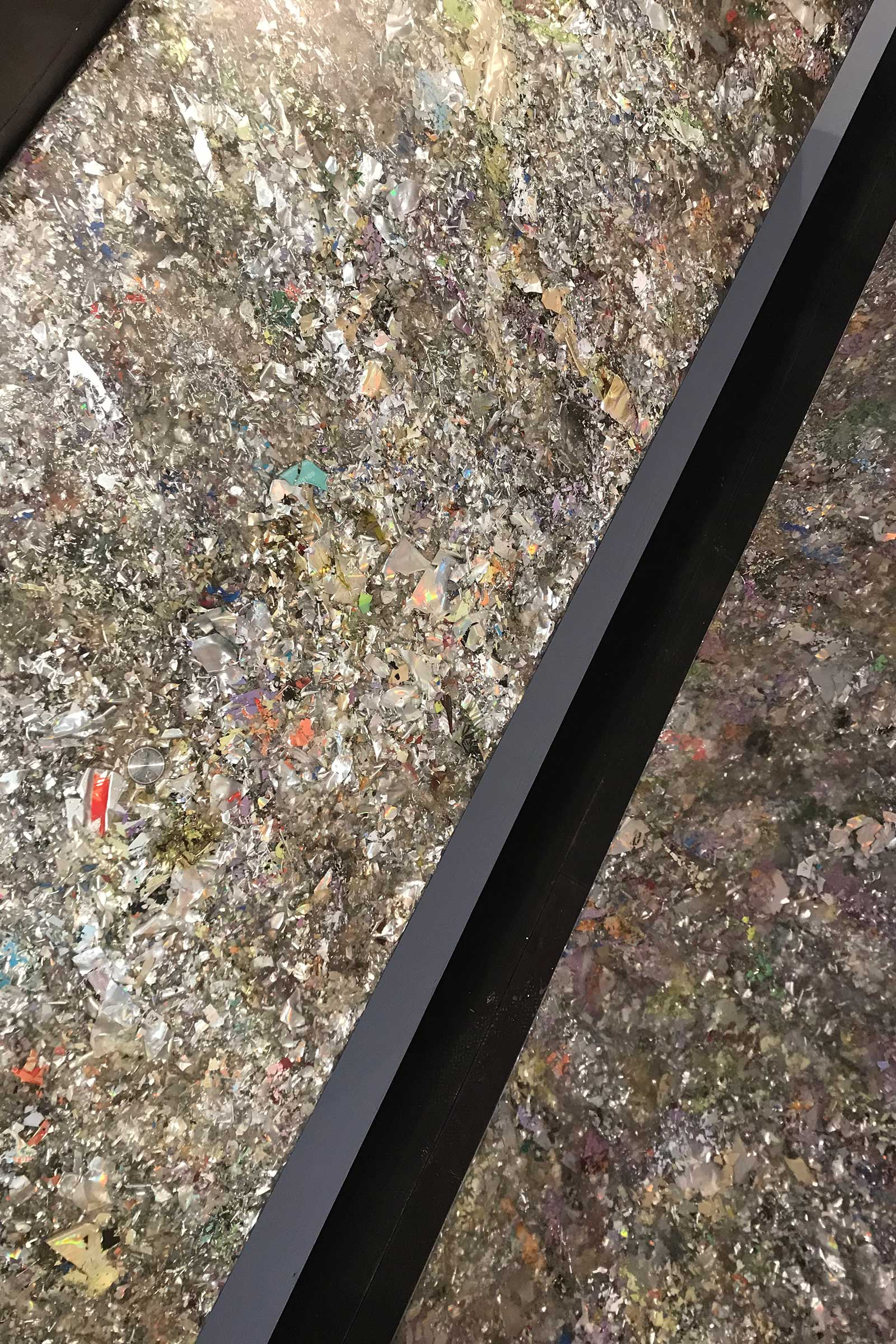 A detail of Dirk Vanderkooij's holographic bench made from fragmented CD-roms and oyster shells set in resin. Images courtesy of Potato Head