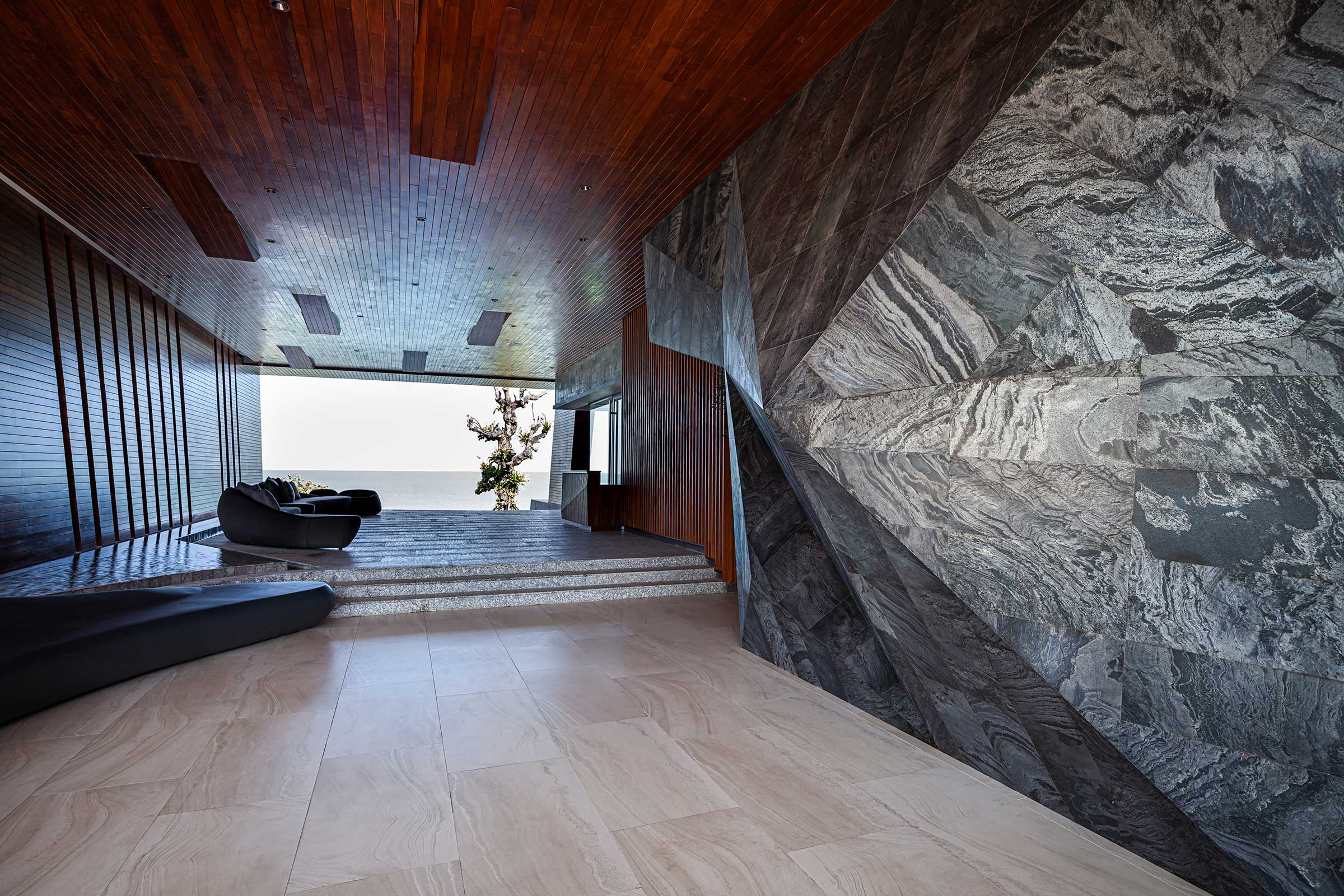 Sculptural-stone-wall-at-the-receptive-tunnel-lobby-space.jpg