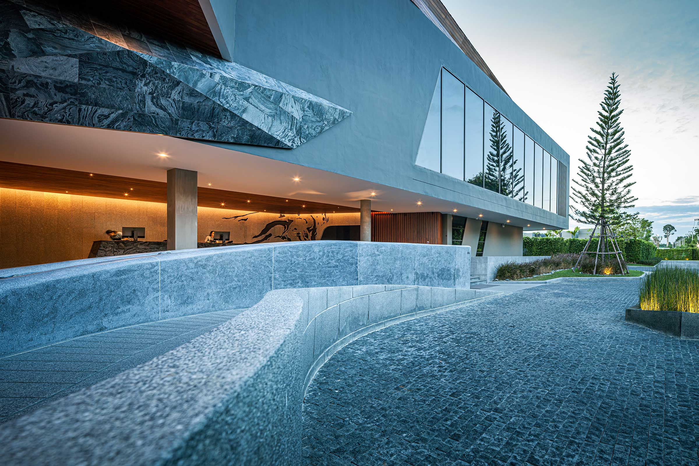 Terrazzo-sculptural-ramp-and-the-massive-function-room-above.jpg