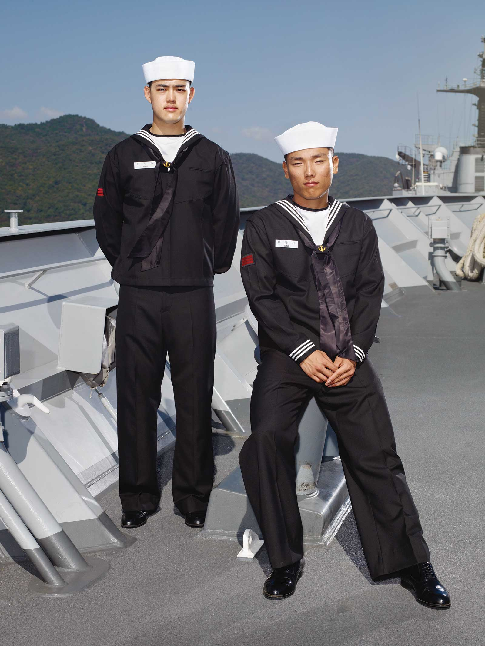 Heinkuhn OH,  Two navy corporals wearing black uniforms ,  October 2010 , 2010. 132 x 105cm, C Print. Image courtesy of the artist