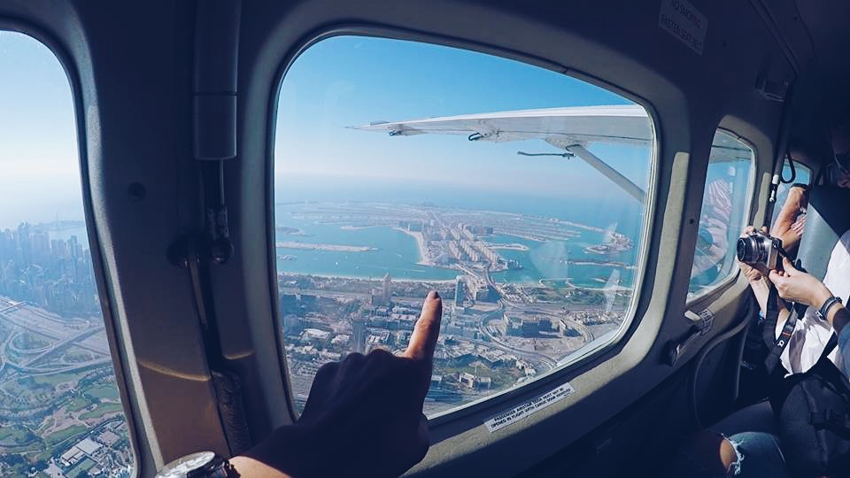 pointing at the palm island carla maria bruno travel influencer travel blogger travel vlogger in dubai with seawings dubai fashion and lifestyle blogger lifestyle vlogger lifestyle influencer bebe swarovski.JPG