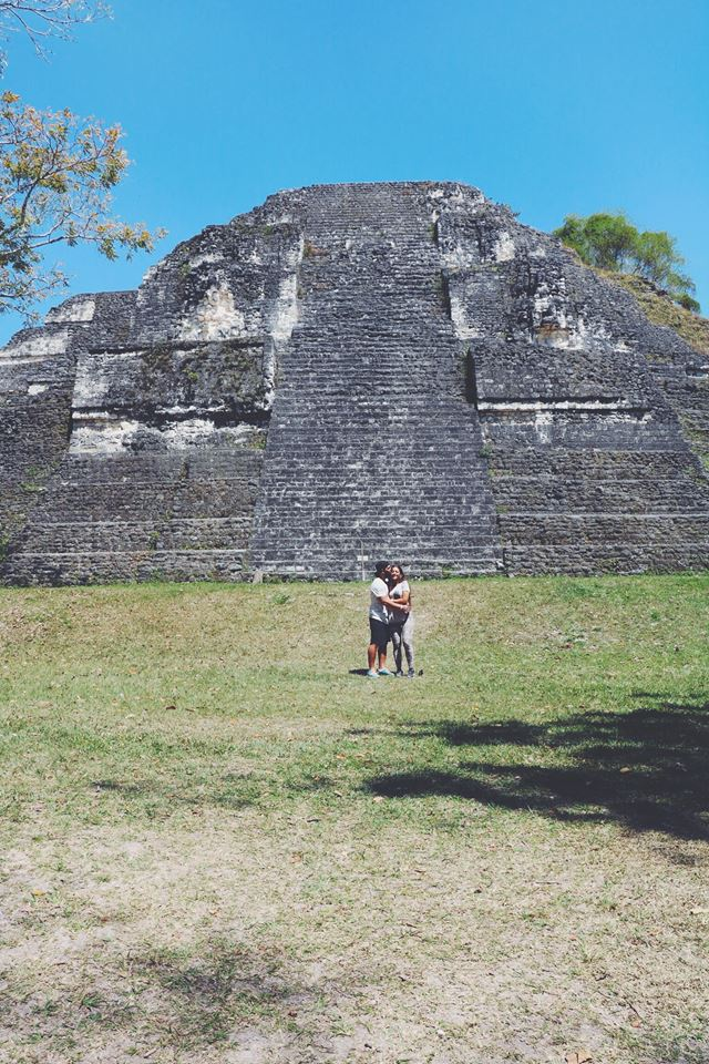 carla and moh by the mayan ruins in tikal flores guatemala mayan tours mayan ruins backpacking carla maria bruno travel blogger vlogger influencer.jpg