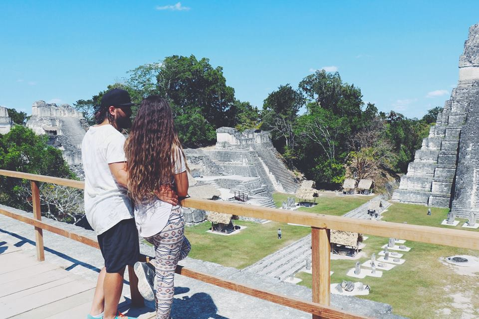 carla and moh looking over the mayan ruins tikal flores guatemala mayan tours mayan ruins backpacking carla maria bruno travel blogger vlogger influencer.jpg