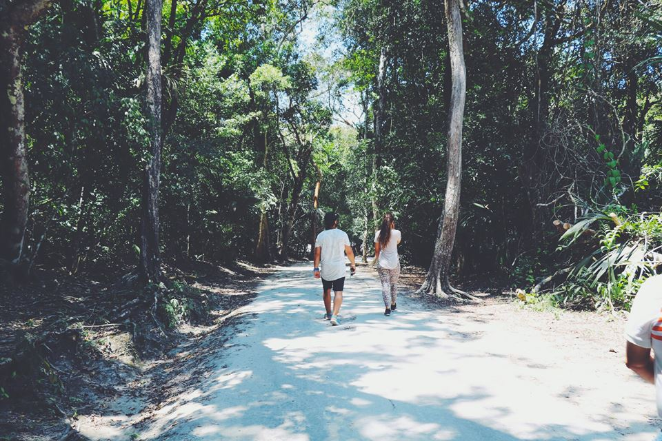 carla hiking with her husband tikal flores guatemala mayan tours mayan ruins backpacking carla maria bruno travel blogger vlogger influencer.jpg