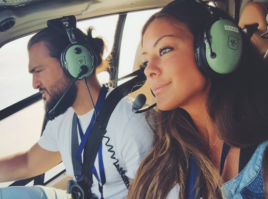 carla and moh on the helicopter dubai helicopter tour fly high dubai what to do in dubai carla maria bruno travel blogger vlogger influencer collaboration.png