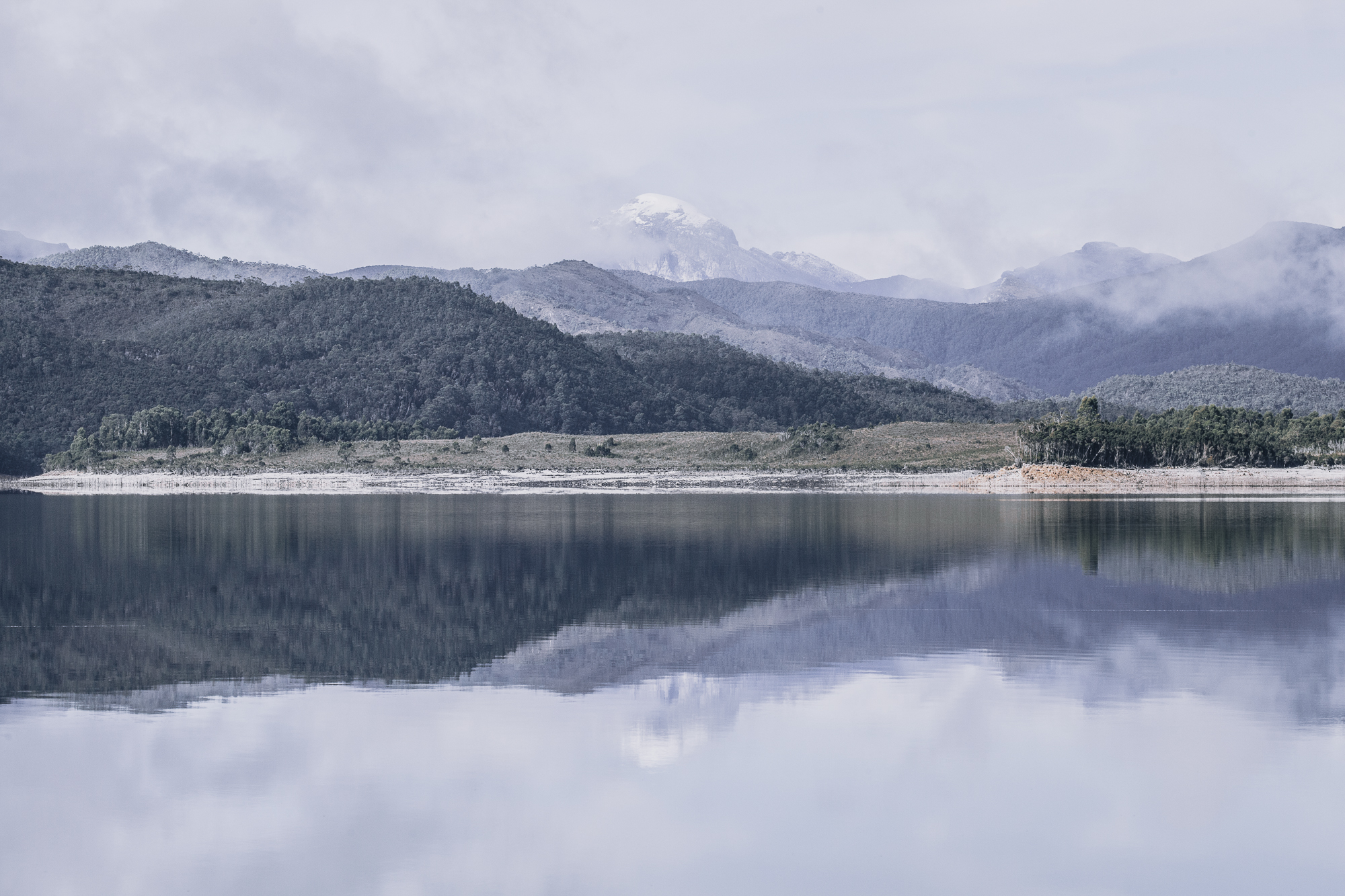 SNOW PEAK   Painterly reflections of a mid-winter dusting.  Location: South West Tasmania.