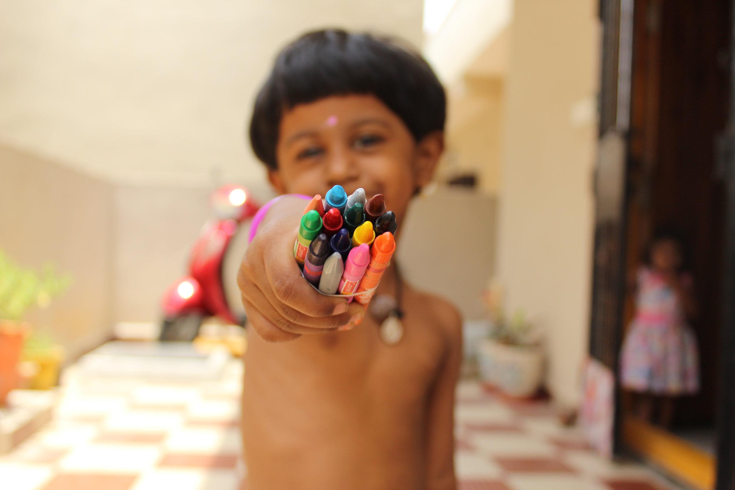 Boy Holding Crayons.jpg