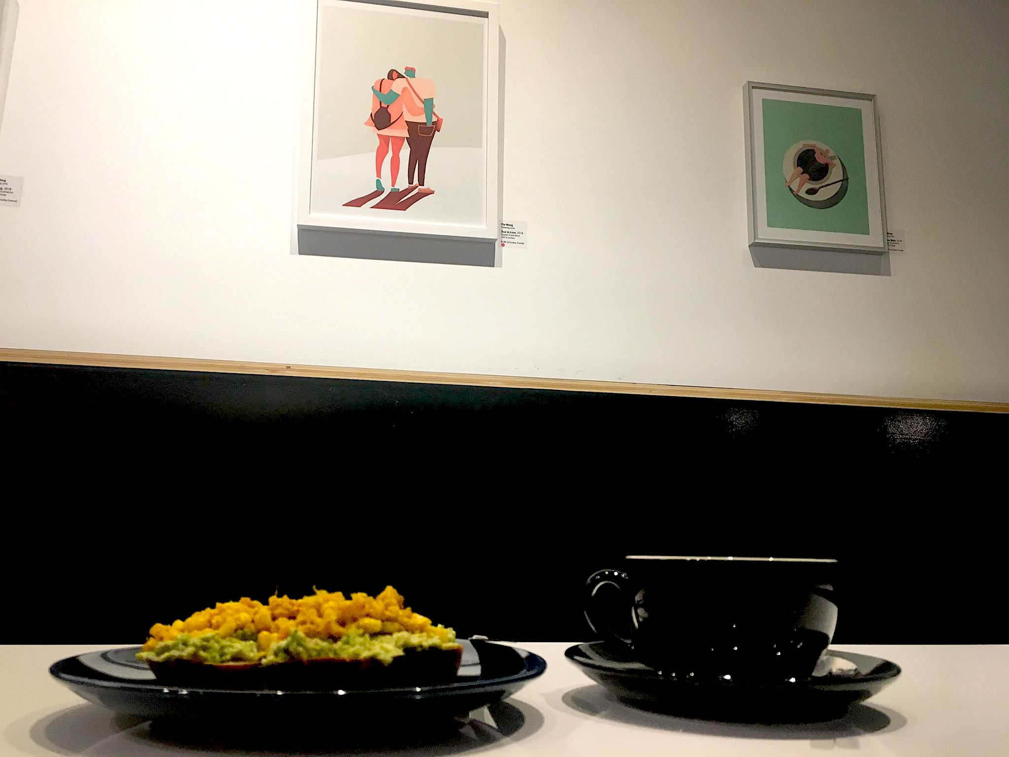 A snapshot of the coffee shop, with my framed images on the walls.